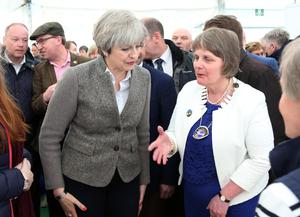 13 May 2017 - Picture by Darren Kidd / Press Eye.     The Prime Minister Theresa May is on a brief visit to Northern Ireland. She arrived at the Balmoral Show in Balmoral Park, near Lisburn in County Antrim on Saturday.  Elizabeth Warden (Federation Chairman) Women's Institute with the Prime Minister Theresa May at the Balmoral Show.