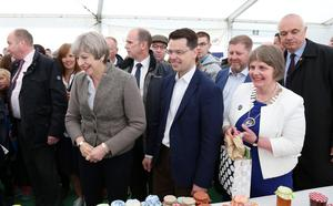 13 May 2017 - Picture by Darren Kidd / Press Eye.     The Prime Minister Theresa May is on a brief visit to Northern Ireland. She arrived at the Balmoral Show in Balmoral Park, near Lisburn in County Antrim on Saturday.  Elizabeth Warden (Federation Chairman) Women's Institute and Secretary of State for Northern Ireland James Brokenshire accompany the Prime Minister Theresa May on her visit to the Balmoral Show.