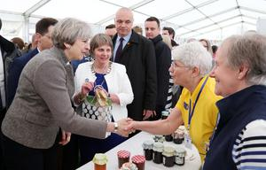 13 May 2017 - Picture by Darren Kidd / Press Eye.     The Prime Minister Theresa May is on a brief visit to Northern Ireland. She arrived at the Balmoral Show in Balmoral Park, near Lisburn in County Antrim on Saturday.  Elizabeth Warden (Federation Chairman) Women's Institute and Lesley Martin and Dorothy Robb  with the Prime Minister Theresa May at the Balmoral Show.