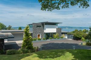 No 4: Bramble rise, Holywood Co Down. Offers over £1,395,000 Bramble Rise  is an amazing home set on an elevated site with panoramic views across Belfast Lough and the County Antrim Hills in Holywood. This unique contemporary property has been finished to an exceptional standard and specification seldom found in Northern Ireland. Each room maximises light and space with tall floor to ceiling windows that show the breathtaking panoramic views over landscaped gardens and to Belfast Lough and the Antrim Hills beyond.
