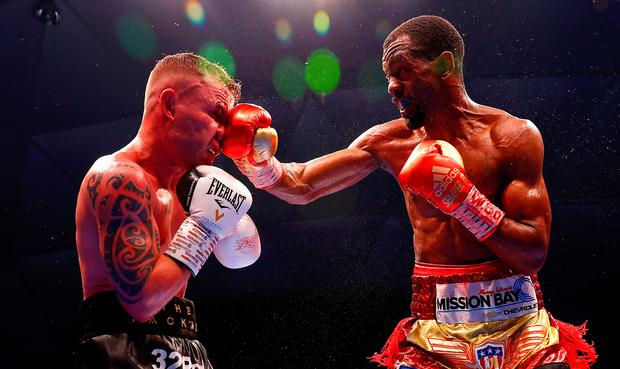 Take that: Jamel Herring lands a blow on Carl Frampton during their world title fight in Dubai