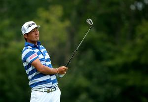 LOUISVILLE, KY - AUGUST 07: Hideto Tanihara of Japan hits his second shot on the ninth hole during the first round of the 96th PGA Championship at Valhalla Golf Club on August 7, 2014 in Louisville, Kentucky.  (Photo by Andrew Redington/Getty Images)