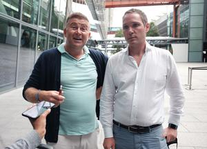 Greg Feehely and Kirk Wylie arrived at Heathrow Airport from Mykonos on Tuesday (Yui Mok/PA Wire)
