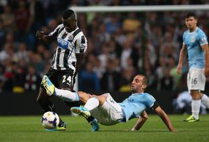 MANCHESTER, ENGLAND - AUGUST 19:  Pablo Zabaleta of Manchester City in action with Cheik Tiote of Newcastle United during the Barclays Premier League match between Manchester City and Newcastle United at the Etihad Stadium on August 19, 2013 in Manchester, England.  (Photo by Clive Brunskill/Getty Images)