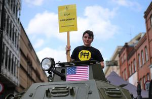 Volunteer Jenn Byrne takes part in a photocall on Grafron Street, Dublin, where Amnesty International called on the US government to immediately end its ongoing deliveries of large quantities of arms to Israel. The organisation is calling for the imposition of a total arms embargo on all parties to the conflict. Photo: Niall Carson/PA