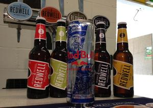 Image from Redwell Brewing of a selection of Redwell beers with a can of Redbull as the independent brewery set up by a group of friends has been threatened with legal action by energy drink manufacturer Red Bull because of the similarity of its name