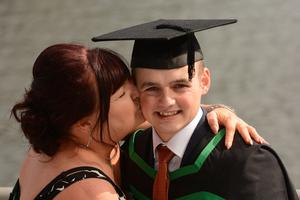 HARRISON PHOTOGRAPHY - BELFAST - 1st July 2016 Graduating from Ulster University today with a degree in Engineering and Design is Scott McDowell getting a big kiss from mum Heather