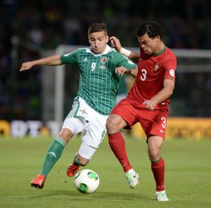 Martin Paterson and Pepe during Friday's 2014 World Cup qualifier between Northern Ireland and Portugal at Windsor park, Belfast. Pic Charles McQuillan/Pacemaker.