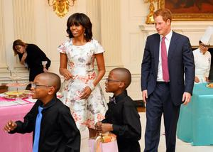 WASHINGTON, DC - MAY 09:  HRH Prince Harry and first lady Michelle Obama prepare to attend an event to honor military families at the White House during the first day of his visit to the United States on May 9, 2013 in Washington, DC. HRH will be undertaking engagements on behalf of charities with which the Prince is closely associated on behalf also of HM Government, with a central theme of supporting injured service personnel from the UK and US forces.  (Photo by John Stillwell - WPA Pool/Getty Images)