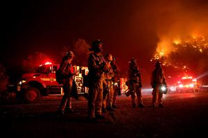 CLEARLAKE, CA - AUGUST 02:  Cal Fire firefighters monitor a backfire ahead of the Rocky Fire on August 2, 2015 near Clearlake, California. Over 1,900 firefighters are battling the Rocky Fire that burned over 22,000 acres since it started on Wednesday afternoon. The fire is currently five percent contained and has destroyed at least 14 homes.  (Photo by Justin Sullivan/Getty Images) *** BESTPIX ***