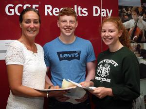 Press Eye © Belfast - Northern Ireland Photo by Freddie Parkinson / Press Eye © Sunday 24 August 2017 Ballyclare High School GCSE Results Day. Principal Dr Michelle Rainey with the McCullough twins Mathew 6A 4B and Rebecca 3A* 6A B.