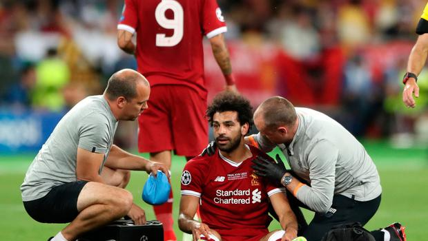Liverpool's Mohamed Salah reacts after picking up an injury during the UEFA Champions League Final at the NSK Olimpiyskiy Stadium, Kiev. Nick Potts/PA Wire