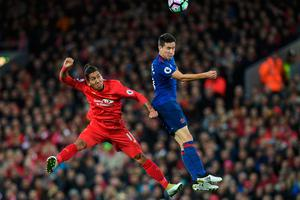 Manchester United's Spanish midfielder Ander Herrera (R) vies with Liverpool's Brazilian midfielder Roberto Firmino during the English Premier League football match between Liverpool and Manchester United at Anfield in Liverpool, north west England on October 17, 2016. AFP/Getty Images