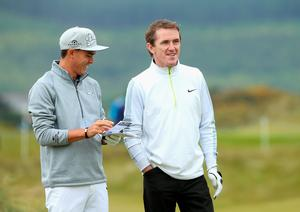 NEWCASTLE, NORTHERN IRELAND - MAY 27:  Rickie Fowler of the Unitd States chats to former Jockey AP McCoy during the Pro-Am round prior to the Irish Open at Royal County Down Golf Club on May 27, 2015 in Newcastle, Northern Ireland.  (Photo by Andrew Redington/Getty Images)