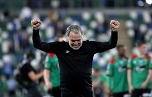Glentoran manager Mick McDermott celebrates Irish Cup success.