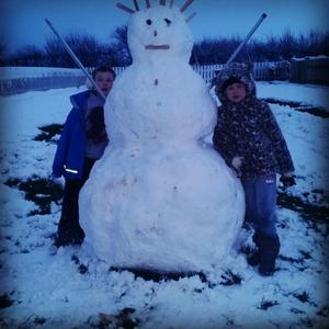 A good day's work in the snow - proudly showing their happy snowman. Pic Michelle Wilmont 14/01/2015