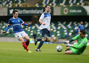 Stranger in their own home: Linfield have competed at Windsor Park against the backdrop of Irish FA branding and advertising