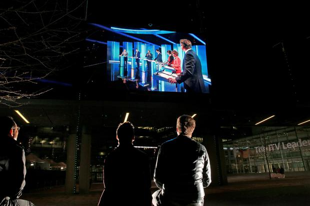 People watch a giant TV screen showing the leaders election debate at Media City on April 2, 2015 in Manchester, England. (Photo by Peter Macdiarmid/Getty Images)