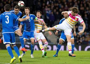 Scotland's Christophe Berra (right) attempts a header at goal during the International Friendly at Hampden Park, Glasgow. PRESS ASSOCIATION Photo. Picture date: Wednesday March 25, 2015. See PA story SOCCER Scotland. Photo credit should read: Kirk O'Rourke/PA Wire. RESTRICTIONS: Use subject to restrictions. Editorial use only. Commercial use only with prior written consent of the Scottish FA. Call +44 (0)1158 447447 for further information.