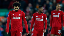 Dropped points: Mo Salah and his Liverpool team-mates show their disappointment after only drawing with Leicester last night
