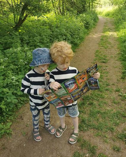 The twins look at a map (Family handout/PA)