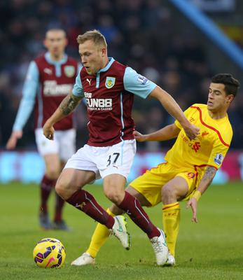 Burnley's Scott Arfield gets away from Liverpool's Philippe Coutinho during the Barclays Premier League match at Turf Moor, Burnley. Dave Thompson/PA Wire.