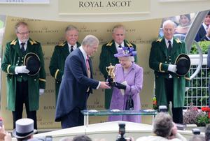 "ASCOT, ENGLAND - JUNE 20:  Queen Elizabeth II is presented The Gold Cup by Prince Andrew, Duke of York after her horse ""Estimate"" won during Ladies Day on Day 3 of Royal Ascot at Ascot Racecourse on June 20, 2013 in Ascot, England.  (Photo by Eamonn M. McCormack/Getty Images)"