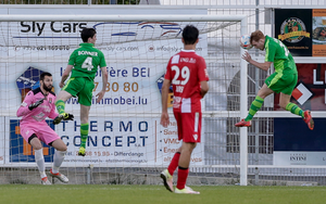 Late drama: Ross Lavery heads home the equaliser against FC Differdange