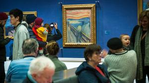 People look at The Scream at the National Gallery in Oslo (Heiko Junge/NTB Scanpix via AP)