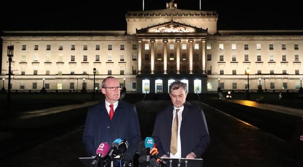Irish Foreign Affairs minister Simon Coveney (left) and Secretary of State for Northern Ireland Julian Smith, issue a statement outside Stormont (Niall Carson/PA)