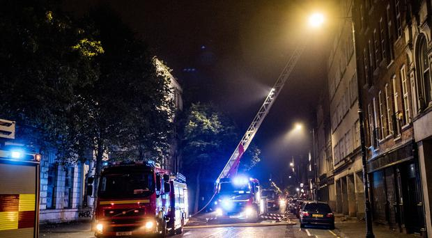 Firefighters at the scene of a blaze in the Cathedral Quarter area of Belfast on September 21st 2019 (Photo by Kevin Scott for Belfast Telegraph)