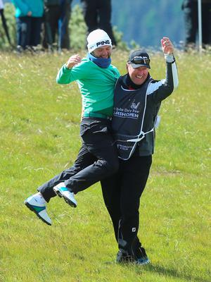 NEWCASTLE, NORTHERN IRELAND - MAY 29:  Andy Sullivan of England celebrates an albatross on the 1st hole with his caddie during the Second Round of the Dubai Duty Free Irish Open Hosted by the Rory Foundation at Royal County Down Golf Club on May 29, 2015 in Newcastle, Northern Ireland.  (Photo by Andrew Redington/Getty Images)