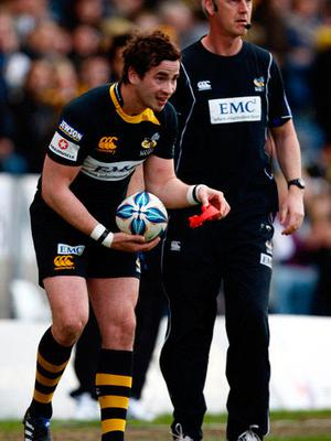Nurturing talent: John with Danny Cipriani at Wasps
