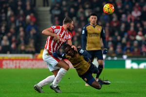 Stoke City's Erik Pieters (left) and Arsenal's Joel Campbell battle for the ball during the Barclays Premier League match at the Britannia Stadium, Stoke.