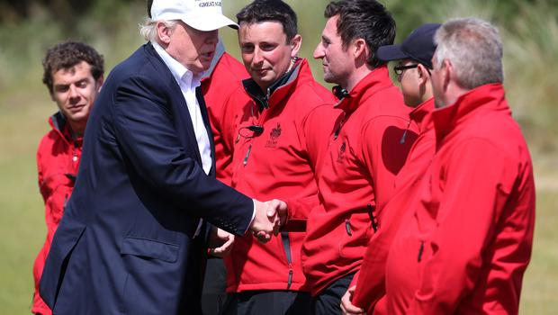 Donald Trump meets staff during a visit to his course at Balmedie (Andrew Milligan/PA)