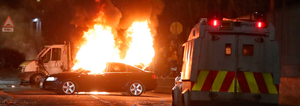 A car is set alight in the Creggan area of Derry last Thursday, the night Lyra McKee was shot dead