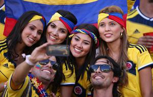 he beautiful game - football fans from around the world -  Colombia fans pose for a photo during the 2014 FIFA World Cup Brazil Group C match between Japan and Colombia at Arena Pantanal on June 24, 2014 in Cuiaba, Brazil.  (Photo by Adam Pretty/Getty Images)