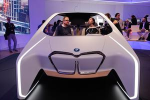 Holger Hampf, BMW's head of user experience, left, and a reporter sit in the BMW i Inside Future concept, at CES International Thursday, Jan. 5, 2017, in Las Vegas. (AP Photo/Jae C. Hong)