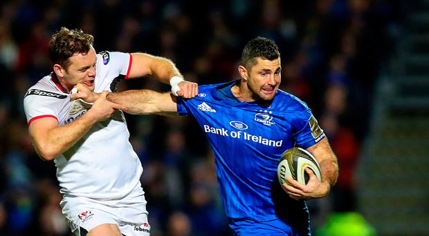 Pulling power: Darren Cave gets to grips with Rob Kearney as Ulster and Leinster clash earlier in the season
