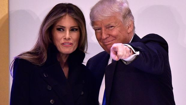 US President-elect Donald Trump (R) and his wife Melania Trump arrive for a leadership luncheon at the Trump International Hotel in Washington, DC on January 19, 2017. Twenty-four hours before he takes the oath of office as the 45th US president, Trump arrived in Washington on Thursday, determined to transform American politics over the next four years. / AFP PHOTO / MANDEL NGANMANDEL NGAN/AFP/Getty Images