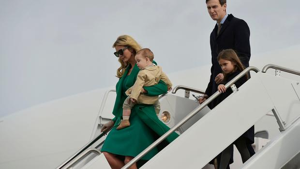 TOPSHOT - US President-elect Donald Trump's daughter Ivanka Trump, her son Theo, her husband Jared Kushner and daughter Arabella, step off a plane upon arrival at Andrews Air Force Base in Maryland on January 19, 2017.  / AFP PHOTO / MANDEL NGANMANDEL NGAN/AFP/Getty Images