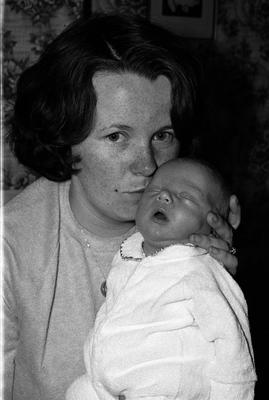 June cradles her son days after John's murder in September 1981