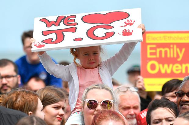 UNSPECIFIED, UNITED KINGDOM - JUNE 07:  A young girl holds a sign as Labour party leader Jeremy Corbyn speaks to supporters on the Promenade on June 7, 2017 in Colwyn Bay, Denbighshire, United Kingdom. The Labour leader is holding six rallies across Scotland, England and Wales today on the final day before polling day in the General Election  (Photo by Anthony Devlin/Getty Images)