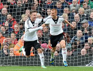 Fulham's Steve Sidwell (right) celebrates scoring his teams opening goal alongside temmate Muamer Tankovic during the Barclays Premier League match at Old Trafford, Manchester.