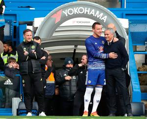 "Manchester United manager Jose Mourinho (right) chats with Chelsea's John Terry before the Premier League match at Stamford Bridge, London. PRESS ASSOCIATION Photo. Picture date: Sunday October 23, 2016. See PA story SOCCER Chelsea. Photo credit should read: Nick Potts/PA Wire. RESTRICTIONS: EDITORIAL USE ONLY No use with unauthorised audio, video, data, fixture lists, club/league logos or ""live"" services. Online in-match use limited to 75 images, no video emulation. No use in betting, games or single club/league/player publications."