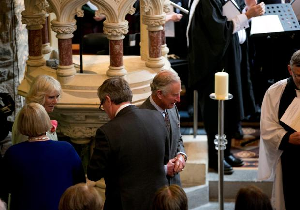 The Prince of Wales (centre) and the Duchess of Cornwall (left) attends a peace and reconciliation prayer service at St. Columba's Church in Drumcliffe on day two of a four day visit to Ireland. PRESS ASSOCIATION Photo. Picture date: Wednesday May 20, 2015. See PA story ROYAL Ireland. Photo credit should read: Colm Mahady/PA Wire