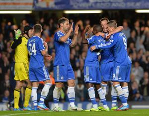 LONDON, ENGLAND - OCTOBER 27:  Fernando Torres of Chelsea celebrates victory at the final whistle with Ramires, Branislav Ivanovic and John Terry of Chelsea during the Barclays Premier League match between Chelsea and Manchester City at Stamford Bridge on October 27, 2013 in London, England.  (Photo by Shaun Botterill/Getty Images)