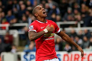 Manchester United's English midfielder Ashley Young celebrates scoring the opening goal of the English Premier League football match between Newcastle and Manchester United at St James Park, Newcastle-Upon-Tyne, north east England on March 4, 2015. Manchester United won the game 1-0. AFP/Getty Images