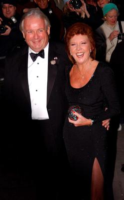 Cilla Black and Christopher Biggins arriving at Claridges Hotel in London for the wedding of actress Joan Collins to Percy Gibson in 2002. Andy Butterton/PA Wire.