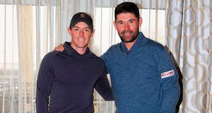 Pals act: Rory McIlroy and his Ryder Cup captain Padraig Harrington